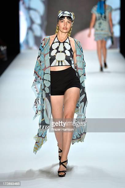 Model Sarina Nowak walks the runway at the Miranda Konstantinidou Show during the MercedesBenz Fashion Week Spring/Summer 2014 at Brandenburg Gate on...