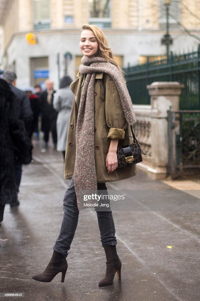 Model Sasha Luss exits the Jean Paul Gaultier show with a Jimmy Choo purse on Day 4 of Paris Haute Couture Fashion Week Spring/Summer 2015 on January...