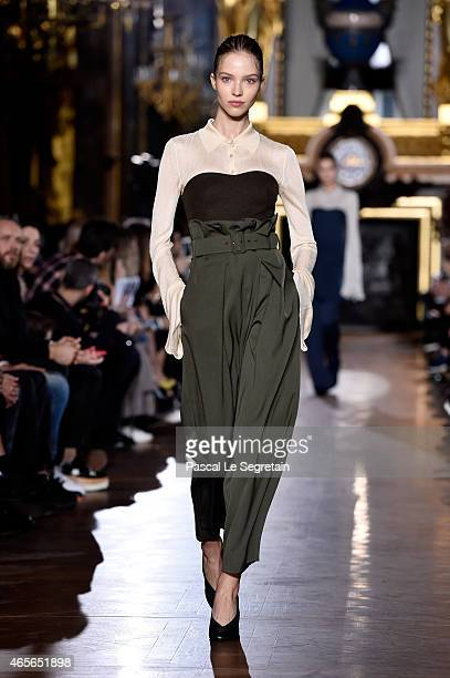 Model Sasha Luss walks the runway during the Stella McCartney show as part of the Paris Fashion Week Womenswear Fall/Winter 2015/2016 on March 9 2015...