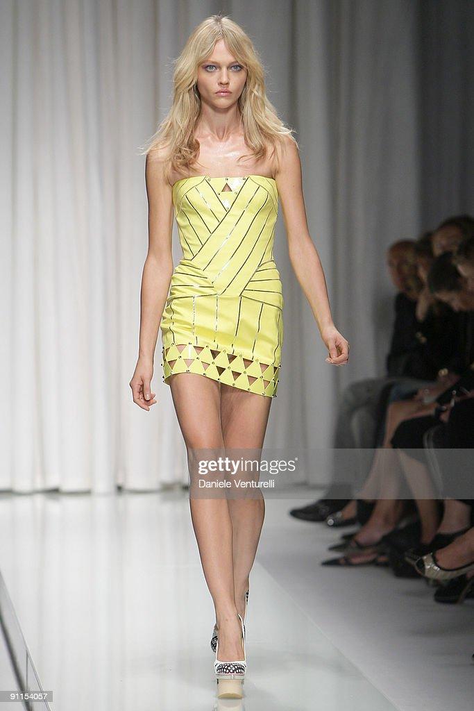 Model Sasha Pivovarova walks down the runway during the Versace show as part of Milan Womenswear Fashion Week Spring/Summer 2010 on September 25 2009...