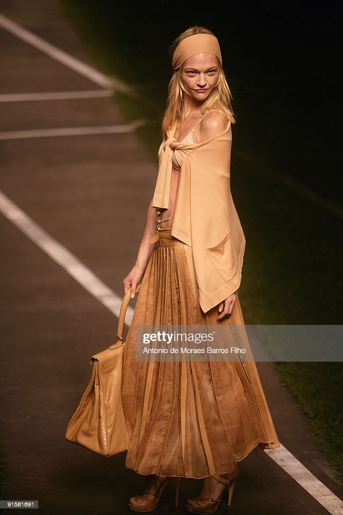 Model Sasha Pivovarova walks the runway at the end of the Hermes Pret a Porter show as part of the Paris Womenswear Fashion Week Spring/Summer 2010...