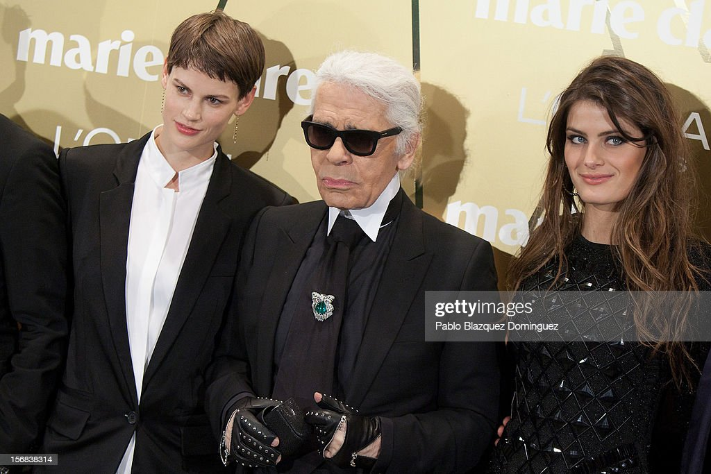 Model Saskia de Brauw, Designer <a gi-track='captionPersonalityLinkClicked' href=/galleries/search?phrase=Karl+Lagerfeld&family=editorial&specificpeople=4330565 ng-click='$event.stopPropagation()'>Karl Lagerfeld</a> and model <a gi-track='captionPersonalityLinkClicked' href=/galleries/search?phrase=Isabeli+Fontana&family=editorial&specificpeople=220508 ng-click='$event.stopPropagation()'>Isabeli Fontana</a> attend Marie Claire Prix de la Moda Awards 2012 at French Embassy on November 22, 2012 in Madrid, Spain.