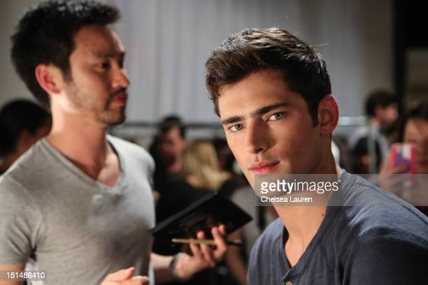 Model Sean O'Pry prepares backstage at the Billy Reid spring 2013 fashion show during MercedesBenz Fashion Week at Eyebeam on September 7 2012 in New...