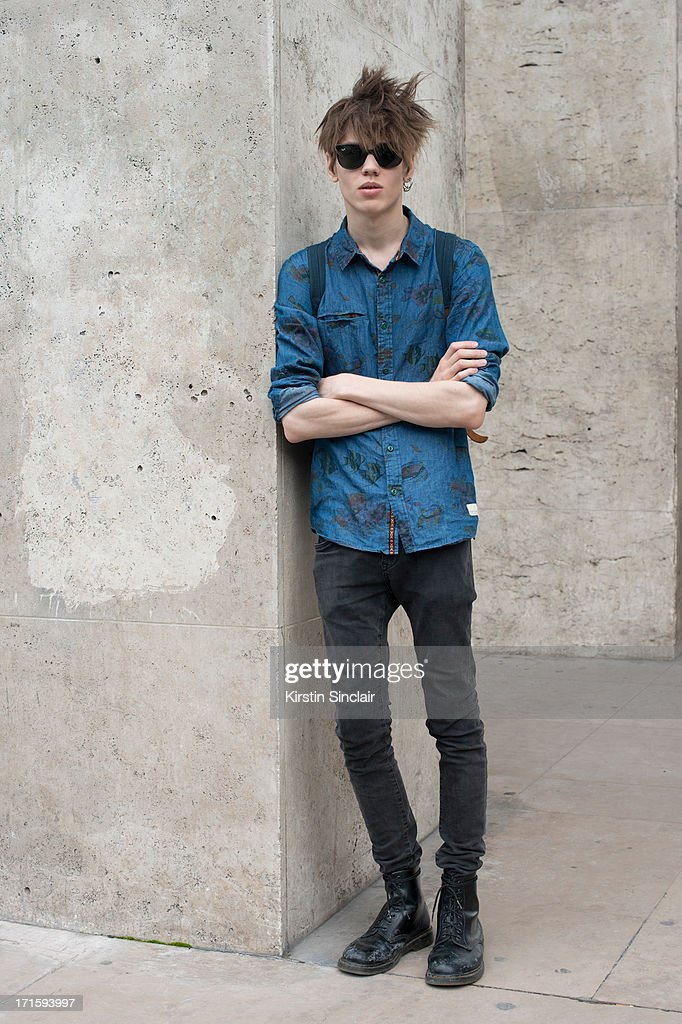 Model Sebastien Ahman wears an Anerrkjendt shirt, Ray Ban sunglasses, H and M jeans and Doc Martens boots on day 1 of Paris Collections: Men on June 26, 2013 in Paris, France.