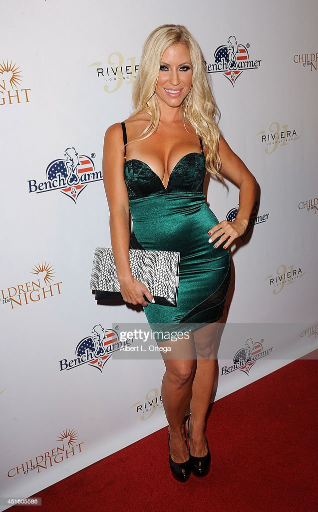 Model Shannon Malone arrives for BenchWarmer's Annual Stars & Stripes Celebration held at Riviera 31 on July 1, 2014 in Beverly Hills, California.