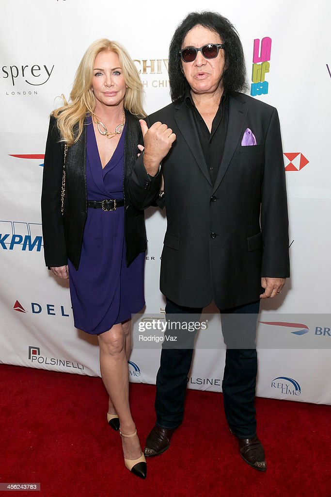 Model Shannon Tweed (L) and musician Gene Simmons attend the The British American Business Council Los Angeles 54th Annual Christmas Luncheon at Fairmont Miramar Hotel on December 13, 2013 in Santa Monica, California.