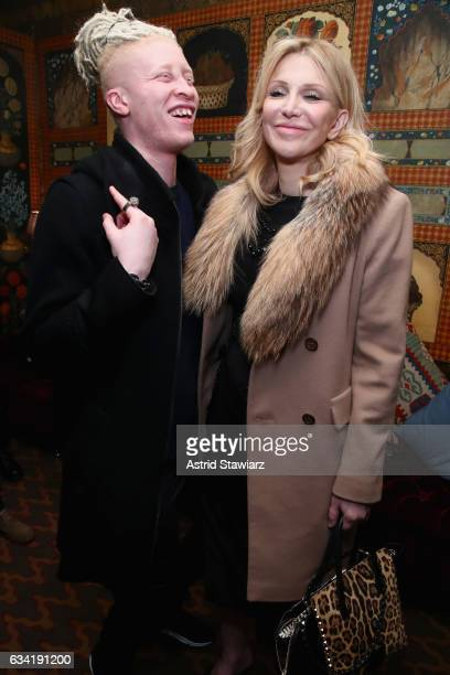 Model Shaun Ross and Courtney Love attend the InStyle March Issue Party By Laura Brown at The Carlisle Hotel on February 7 2017 in New York City