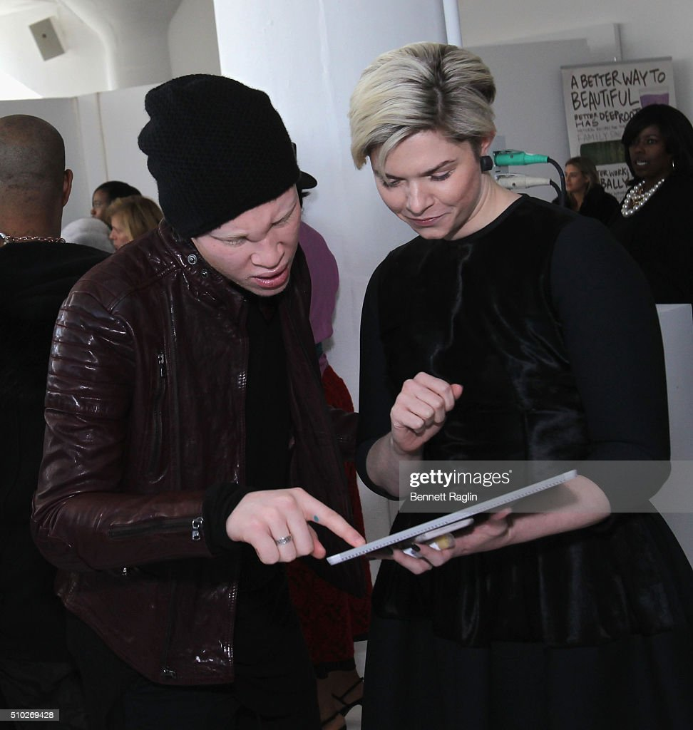 Model Shaun Ross (L) and guest attend backstage at SheaMoisture at Laquan Smith F/W 2016 NYFW at Jack Studios on February 14, 2016 in New York City.