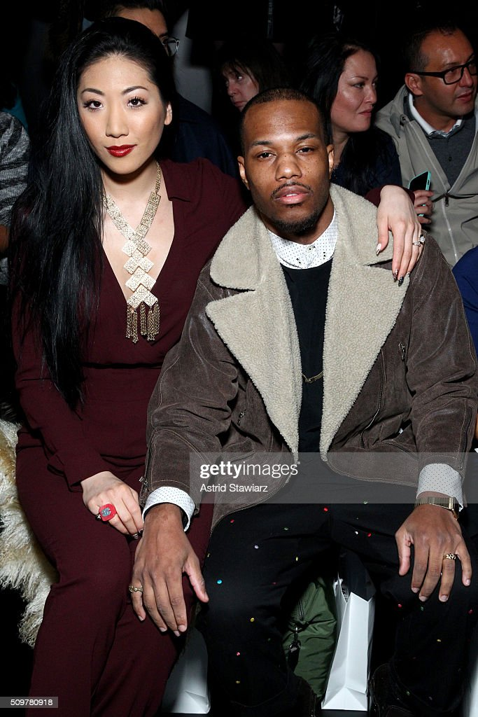 Model Sheena Sakai and musician Josh Baze attend the Concept Korea Fall 2016 fashion show during New York Fashion Week: The Shows at The Dock, Skylight at Moynihan Station on February 12, 2016 in New York City.