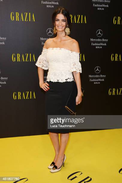 Model Shermine Shahrivar arrives for the Opening Night by Grazia fashion show during the MercedesBenz Fashion Week Spring/Summer 2015 at Erika Hess...