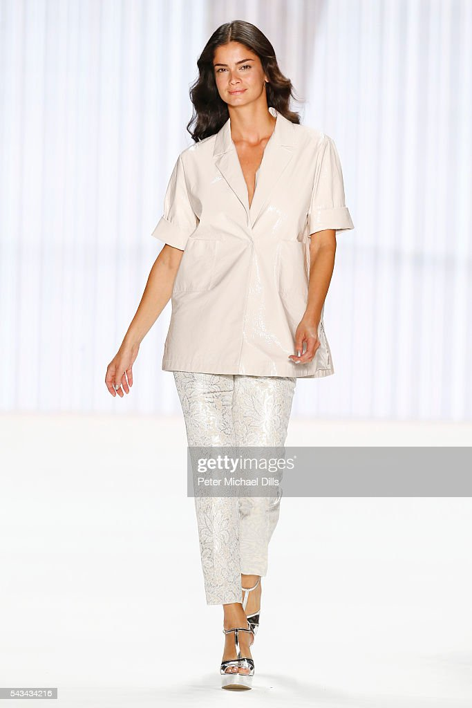 Model <a gi-track='captionPersonalityLinkClicked' href=/galleries/search?phrase=Shermine+Shahrivar&family=editorial&specificpeople=2134098 ng-click='$event.stopPropagation()'>Shermine Shahrivar</a> walks the runway at the Riani show during the Mercedes-Benz Fashion Week Berlin Spring/Summer 2017 at Erika Hess Eisstadion on June 28, 2016 in Berlin, Germany.
