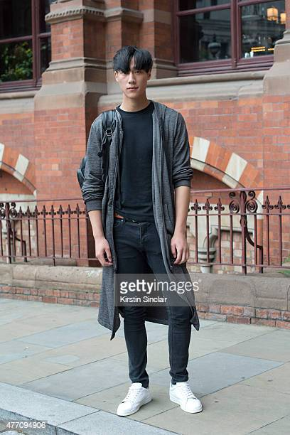 Model Shi Qi Fan wears a H and M jacket Tshirt and jeans and Peace Bird trainers on day 2 of London Collections Men on June 13 2015 in London England