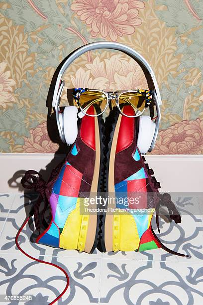 Model Shlomit Malka's style inspirations are photographed for Madame Figaro on April 9 2015 in Paris France Sunglasses sneakers personal headphones...