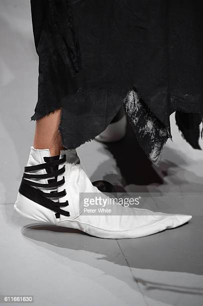 A model shoe detail walks the runway during the Aganovich show as part of the Paris Fashion Week Womenswear Spring/Summer 2017 on September 28 2016...