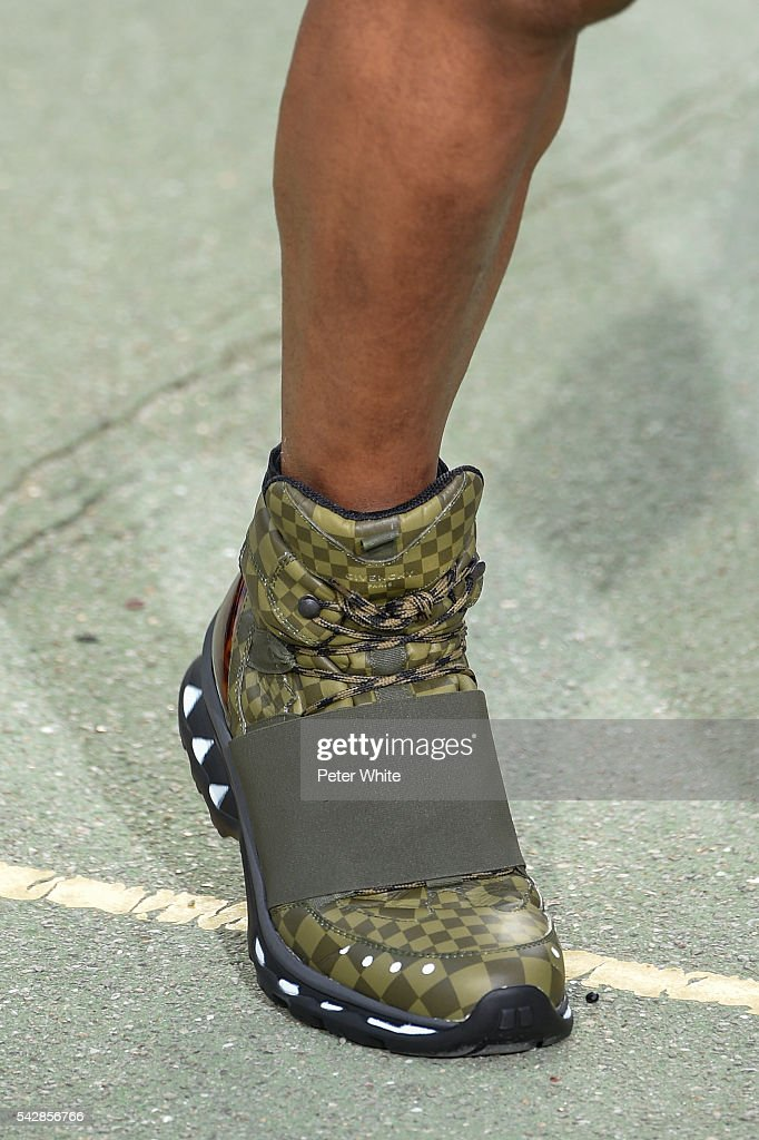 A model, shoes details, walks the runway during the Givenchy Menswear Spring/Summer 2017 show as part of Paris Fashion Week on June 24, 2016 in Paris, France.