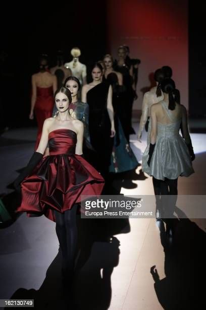 Model showcas designs by Hannibal Laguna on the runway at the Hannibal Laguna show during Mercedes Benz Fashion Week Madrid Fall/Winter 2013/14 at...