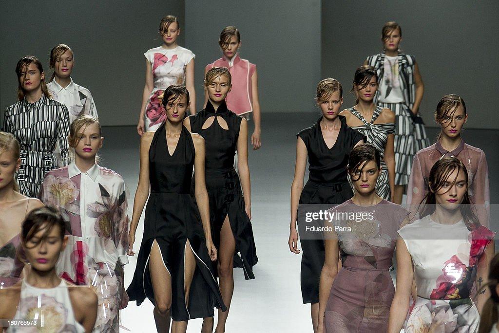 Model showcase designs by Juan Vidal on the runway at Juan Vidal show during Mercedes Benz Fashion Week Madrid Spring/Summer 2014 at Ifema on September 16, 2013 in Madrid, Spain.