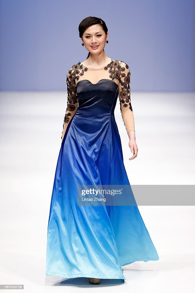 A model showcase designs on the catwalk during the Art School Northeast Dianli University Graduates Show on the second day of China Graduate Fashion Week at 751D.PARK Workshop on April 25, 2013 in Beijing, China.