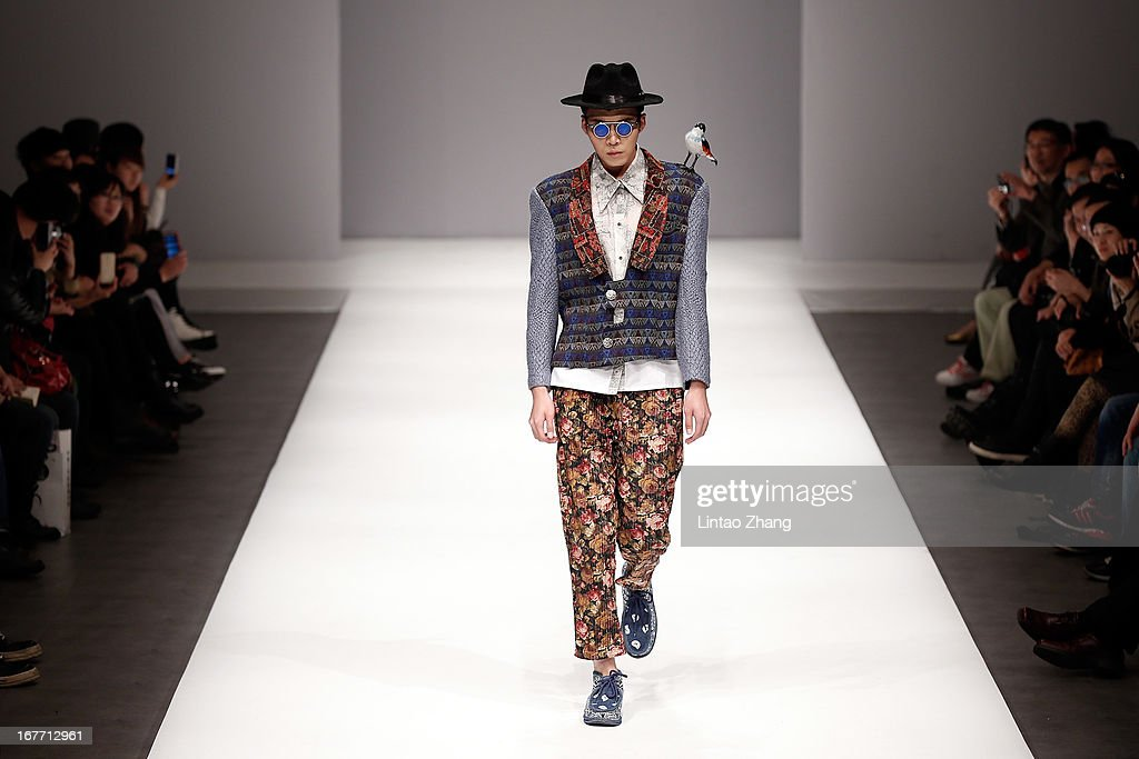 A model showcase designs on the catwalk during the School of Fashion Dalian Polytechnic University Graduates Show on the Fifth day of China Graduate Fashion Week at 751D.PARK Central Hall on April 28, 2013 in Beijing, China.