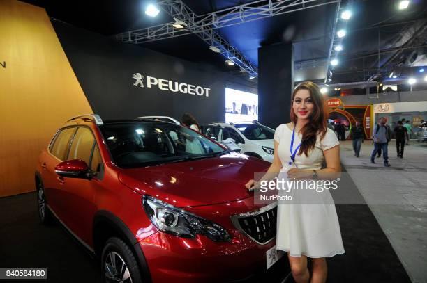 A model showcase Peugeot Car at the 12th Annual Nepals biggest NADA Auto at Bhikuti Mandap Kathmandu Nepal on Tuesday August 29 2017