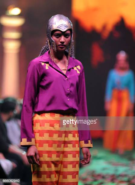 A model showcases a collection inspired by the upcoming Hindi film 'Baahubali 2' in Mumbai on April 7 2017 / AFP PHOTO /