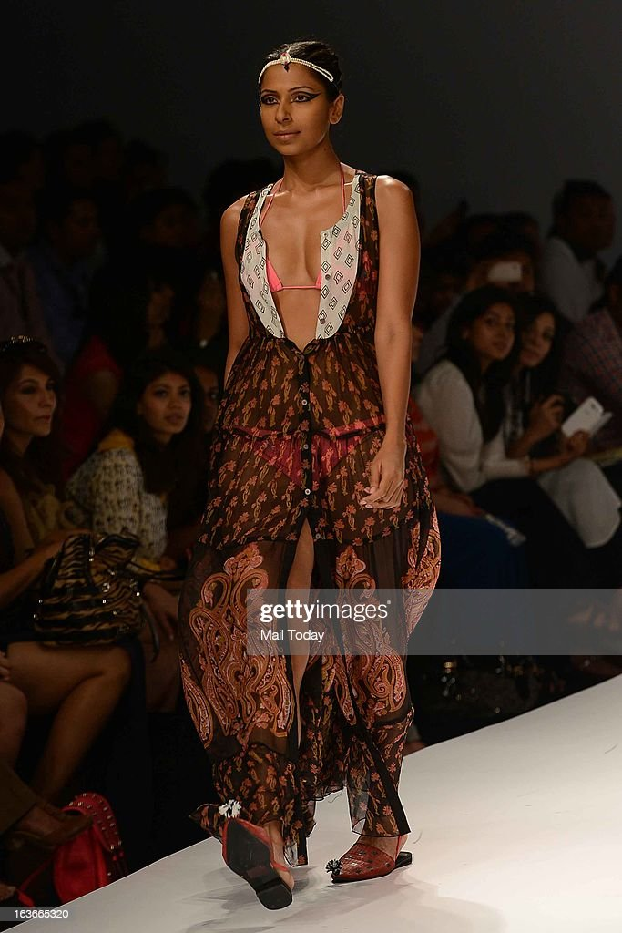 A model showcases a creation by designer Anupamma at Wills Lifestyle India Fashion Week in New Delhi on March 13, 2013.