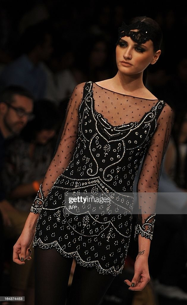 A model showcases a creation by designer Rocky Star during a fashion show on the second day of Lakme Fashion Week (LFW) summer/resort 2013 in Mumbai on March 23, 2013. The LFW, held twice annually, featuring creations by over 87 designers and will culminate on March 26.