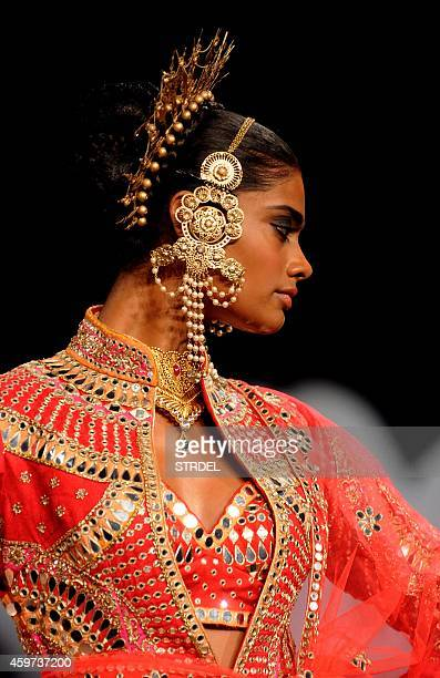 A model showcases a creation by designer Suneet Varme during the Blenders Pride Fashion Tour 2014 in Mumbai on November 29 2014 AFP PHOTO/STR