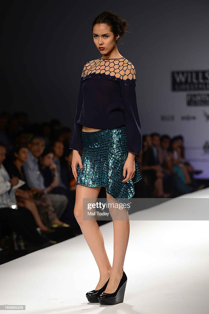 A model showcases a creation by designer Surily at Wills Lifestyle India Fashion Week in New Delhi on March 13, 2013.