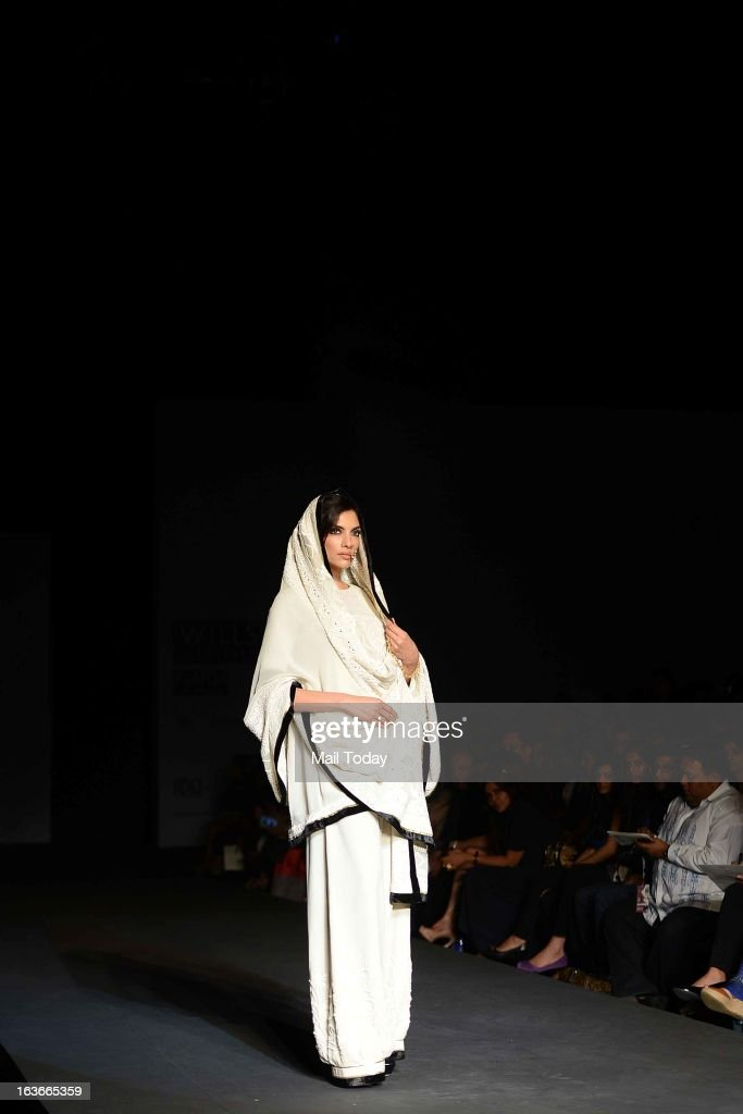 A model showcases a creation by designer Vineet Bahl at Wills Lifestyle India Fashion Week in New Delhi on March 13, 2013.