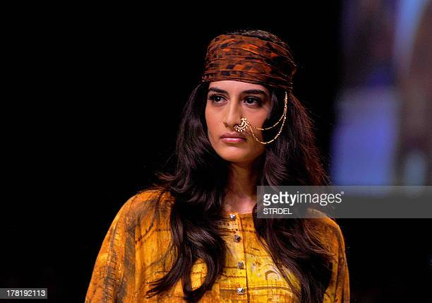 A model showcases a creation by Indian designer Archana Kochhar during the Lakme Fashion Week Winter/Festival 2013 in Mumbai on August 27 2013 AFP...