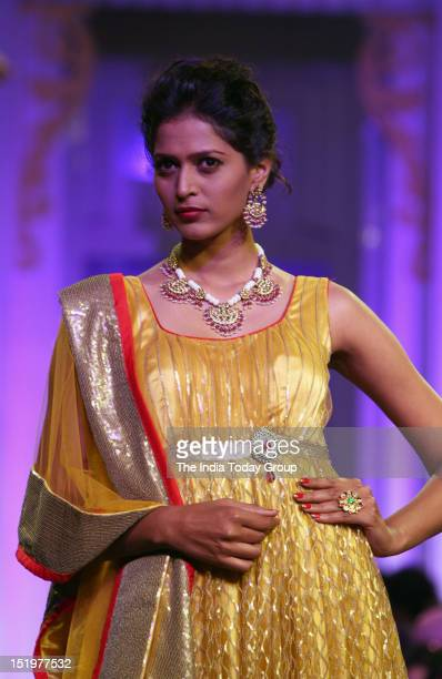 A model showcases a creation by Indian designer Jyotsna Tiwari during Aamby Valley India Bridal Fashion Week 2012 in Mumbai