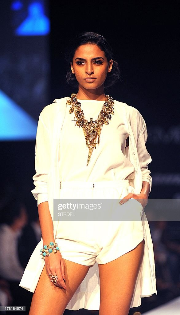 A model showcases a creation by Indian designers Jilani Sutariya and Heena Surani during the Lakme Fashion Week (LFW) Winter/Festival 2013 in Mumbai on August 27, 2013. AFP PHOTO/ STR