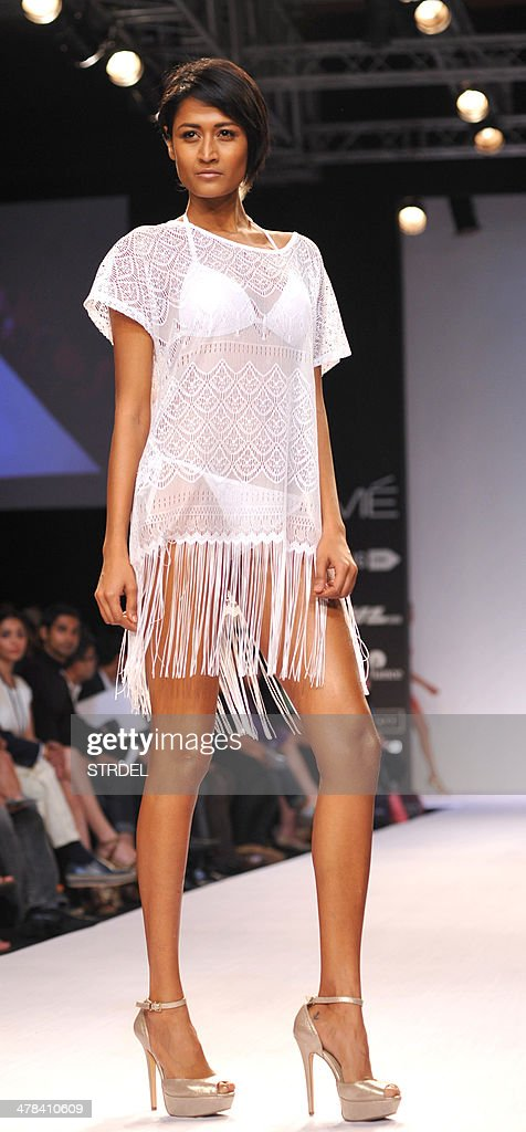 A model showcases a creation by Jabong on the third day of the Lakme Fashion Week (LFW) summer/resort 2014 in Mumbai on March 13, 2014.
