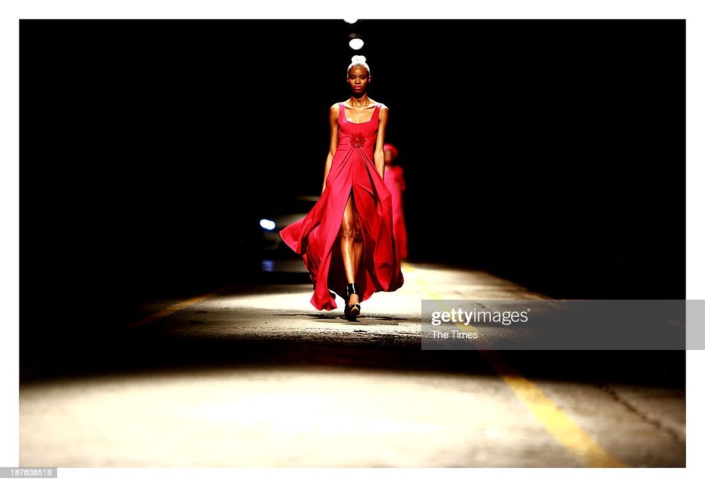 A model showcases a design by David Tlale during the Mercedes-Benz Fashion Week on November 3, 2013 in Pretoria, South Africa. The show took place in Pretoria for the first time over weekend, with David Tlale stealing the show by presenting his collection on a railway platform at the Ravos Rail Station.