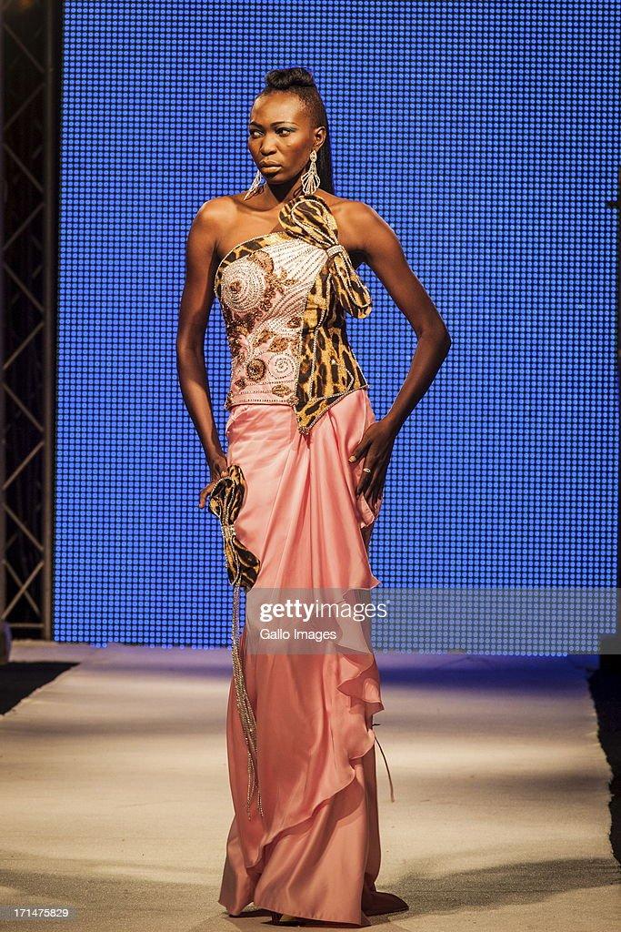 A model showcases a design by Habib Sangare at the Dakar Fashion Week on June 22, 2013, in Dakar, Senegal.