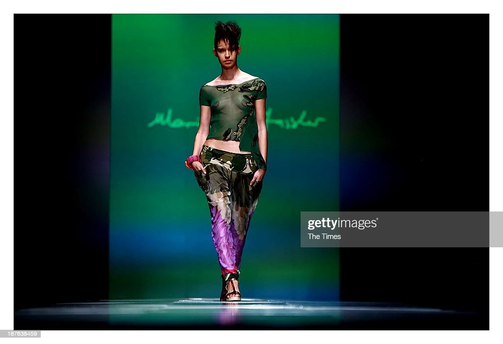 A model showcases a design by Marianne Fassler during the Mercedes-Benz Fashion Week on November 3, 2013 in Pretoria, South Africa. The show took place in Pretoria for the first time over weekend, with David Tlale stealing the show by presenting his collection on a railway platform at the Ravos Rail Station.