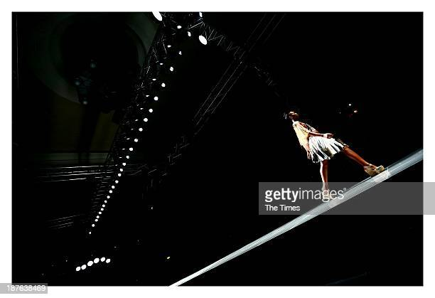 A model showcases a design by Marianne Fassler during the MercedesBenz Fashion Week on November 3 2013 in Pretoria South Africa The show took place...
