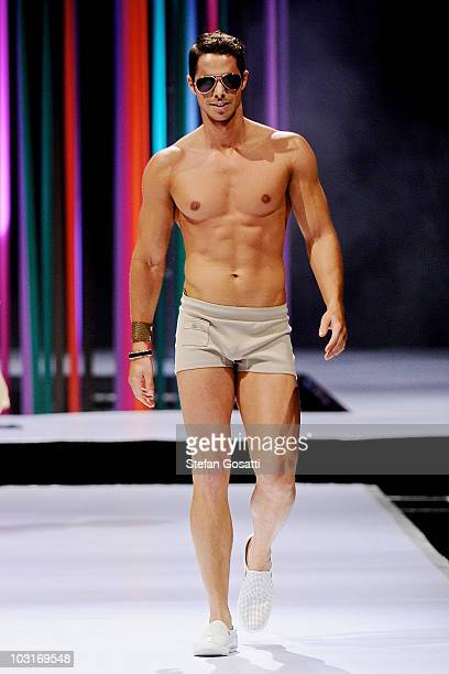 A model showcases a design by Timothy Goldbold on the catwalk during the StyleAid Perth Fashion Event 2010 at the Burswood Entertainment Complex on...