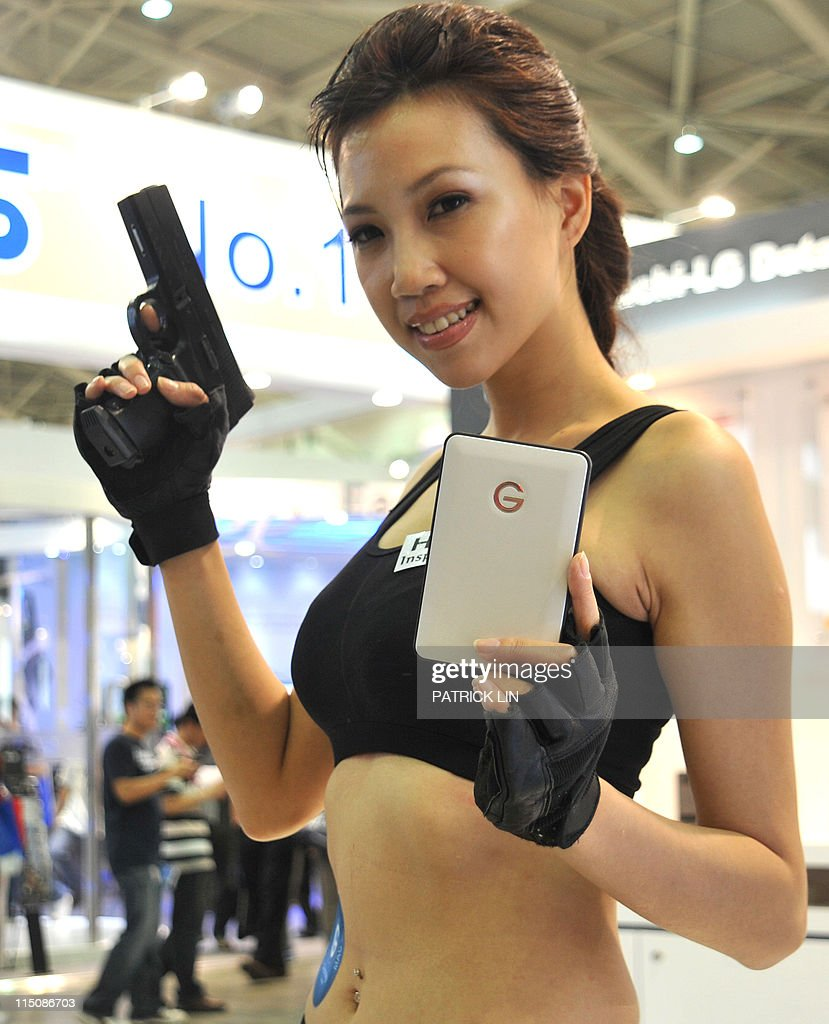 A model showcases a portable hard-disk developed by Hitachi, at Computex Taipei, Asia's biggest information technology and communications trade fair, on June 3, 2011. Around 1,800 exhibitors from across the world displayed their latest lines of products in the five-day trade extravagansa beginning from May 31.
