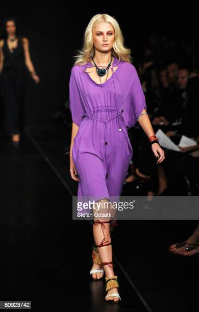 A model showcases an outift by designer Ginger Smart on the catwalk during the third day of the Rosemount Australian Fashion Week Spring/Summer...