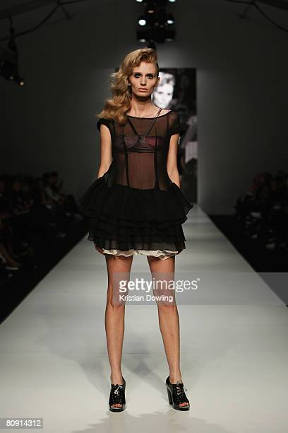 A model showcases an outift by designer Jessie Hill on the catwalk during the second day of the Rosemount Australian Fashion Week Spring/Summer...