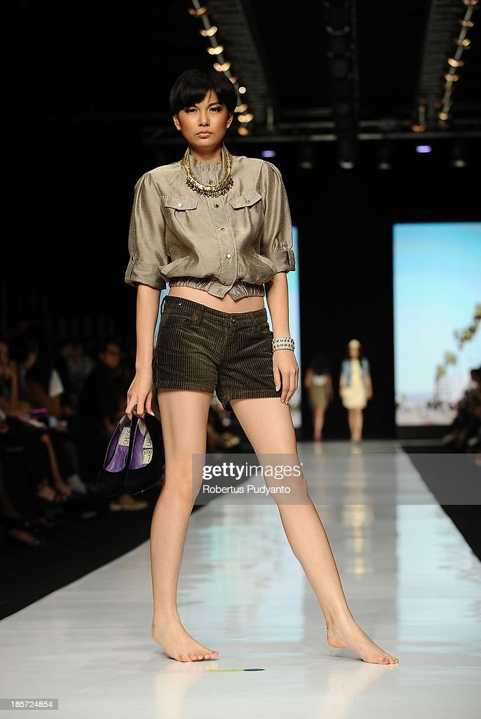 A model showcases collections by Matahari on the runway at the Nature Edgy show during Jakarta Fashion Week 2014 at Senayan City on October 24, 2013 in Jakarta, Indonesia.