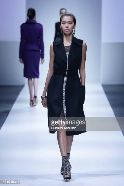 A model showcases design by Oscar de la Renta Fall 2014 Collection during the Audi Fashion Festival on day five at Tent at Orchard on May 18 2014 in...