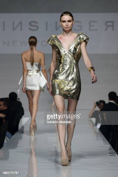 A model showcases design by Rubin Singer during the Audi Red Carpet Night at Tent at Orchard on May 13 2014 in Singapore