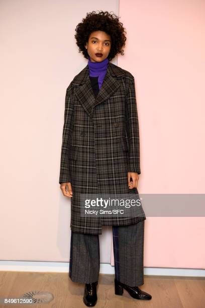 A model showcases designs at the A By Jigsaw presentation during London Fashion Week September 2017 on September 19 2017 in London England