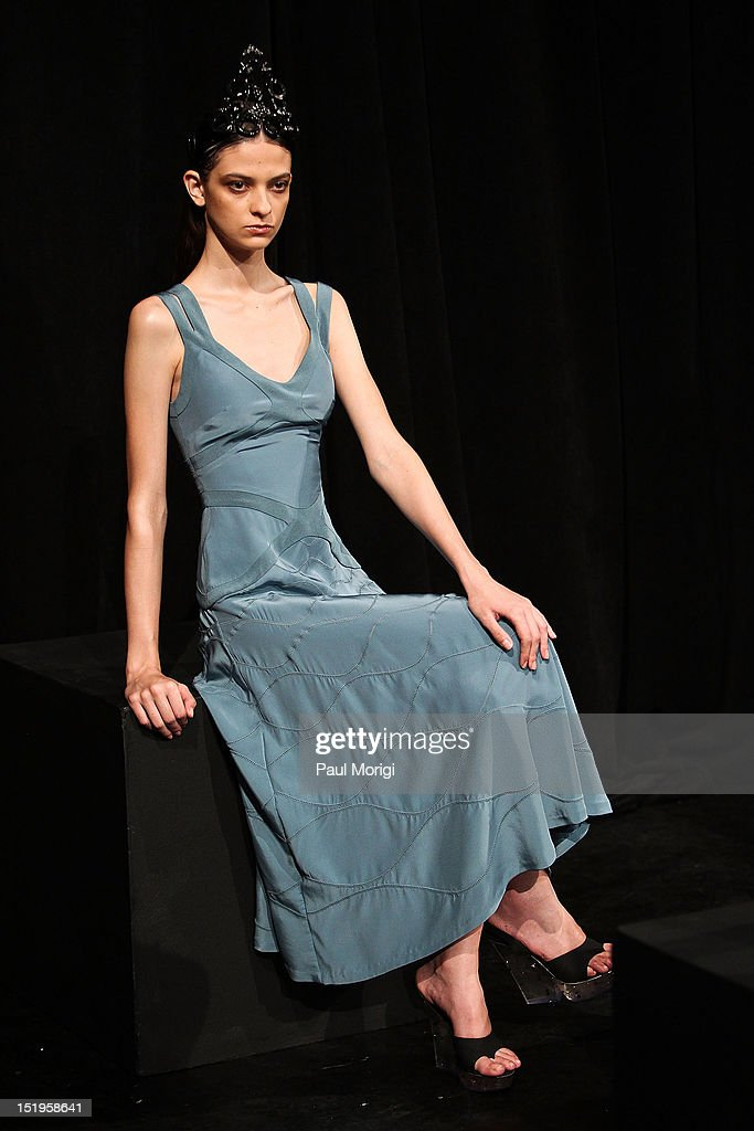 A model showcases designs at the Giulietta presentation during Spring 2013 Mercedes-Benz Fashion Week at Classic Car Club on September 13, 2012 in New York City.