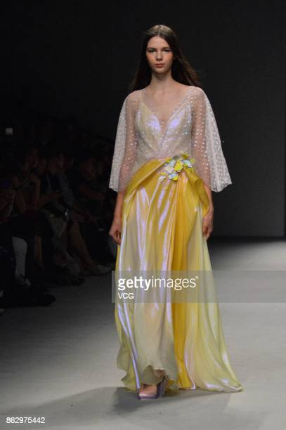 A model showcases designs at We Couture show as part of the Shanghai Fashion Week Spring/Summer 2018 at Xintiandi Hall A on October 17 2017 in...