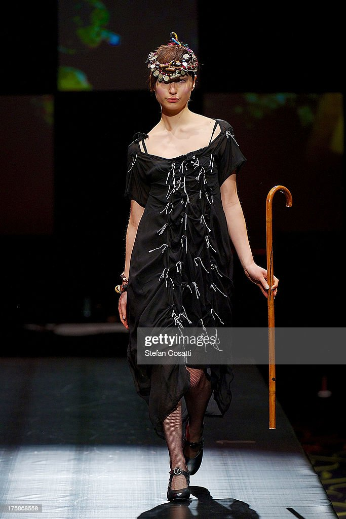 A model showcases designs by 33 Poets on the catwalk during StyleAID 2013 at Crown Perth on August 9, 2013 in Perth, Australia.