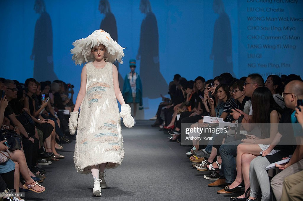 A model showcases designs by a student of Hong Kong Design Institute on the runway during the HKDI Fashion Talent Show on day 3 of Hong Kong Fashion Week Spring/Summer 2014 at the Hong Kong Convention and Exhibition Centre on July 9, 2014 in Hong Kong.
